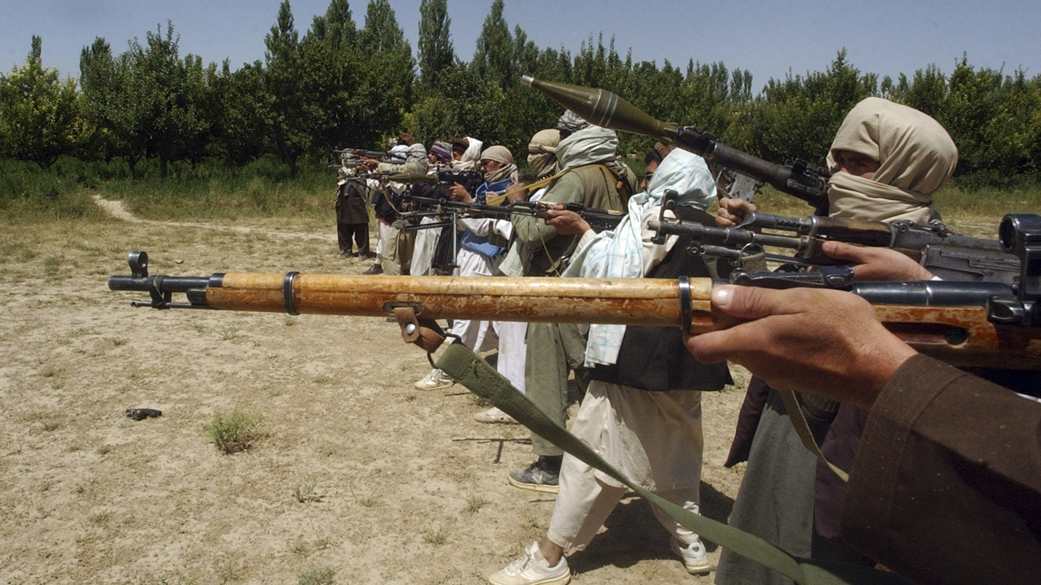 Taliban fighters train with their weapons in an undisclosed location in Afghanistan July 14, 2009.