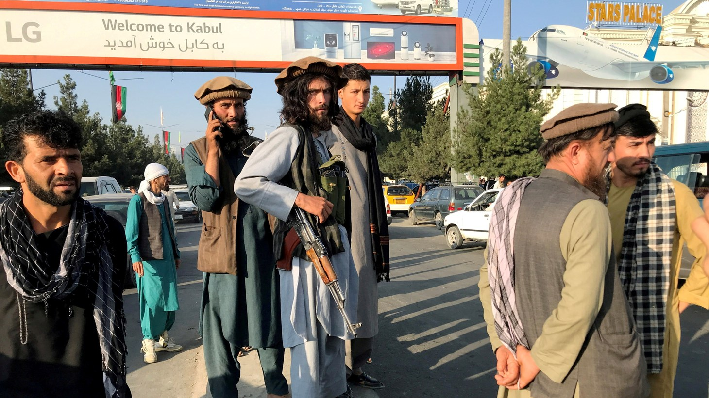 A member of the Taliban stands outside Hamid Karzai International Airport in Kabul, Afghanistan, August 16.