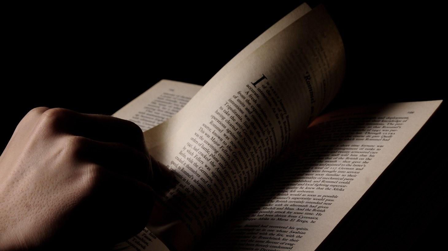 Flipping through a book.