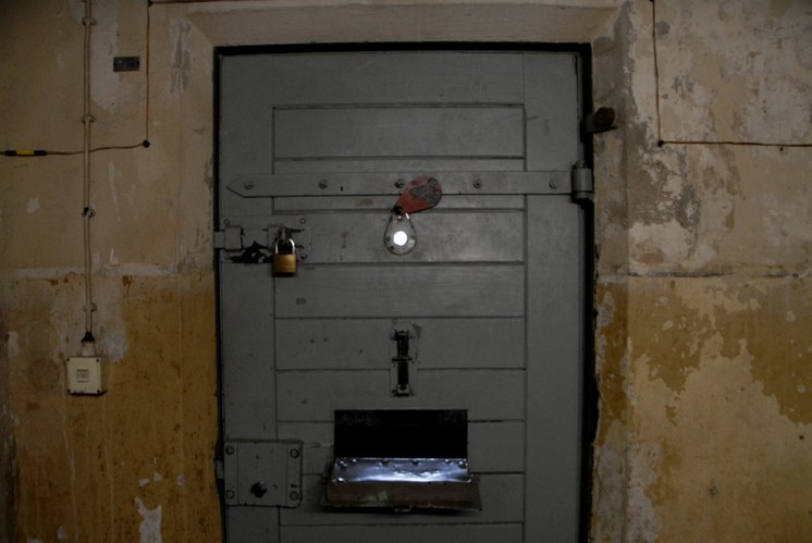 Prisoners were not allowed to lie down during the day. Guards would peak through little holes in the door to make sure prisoners were not breaking the rules.