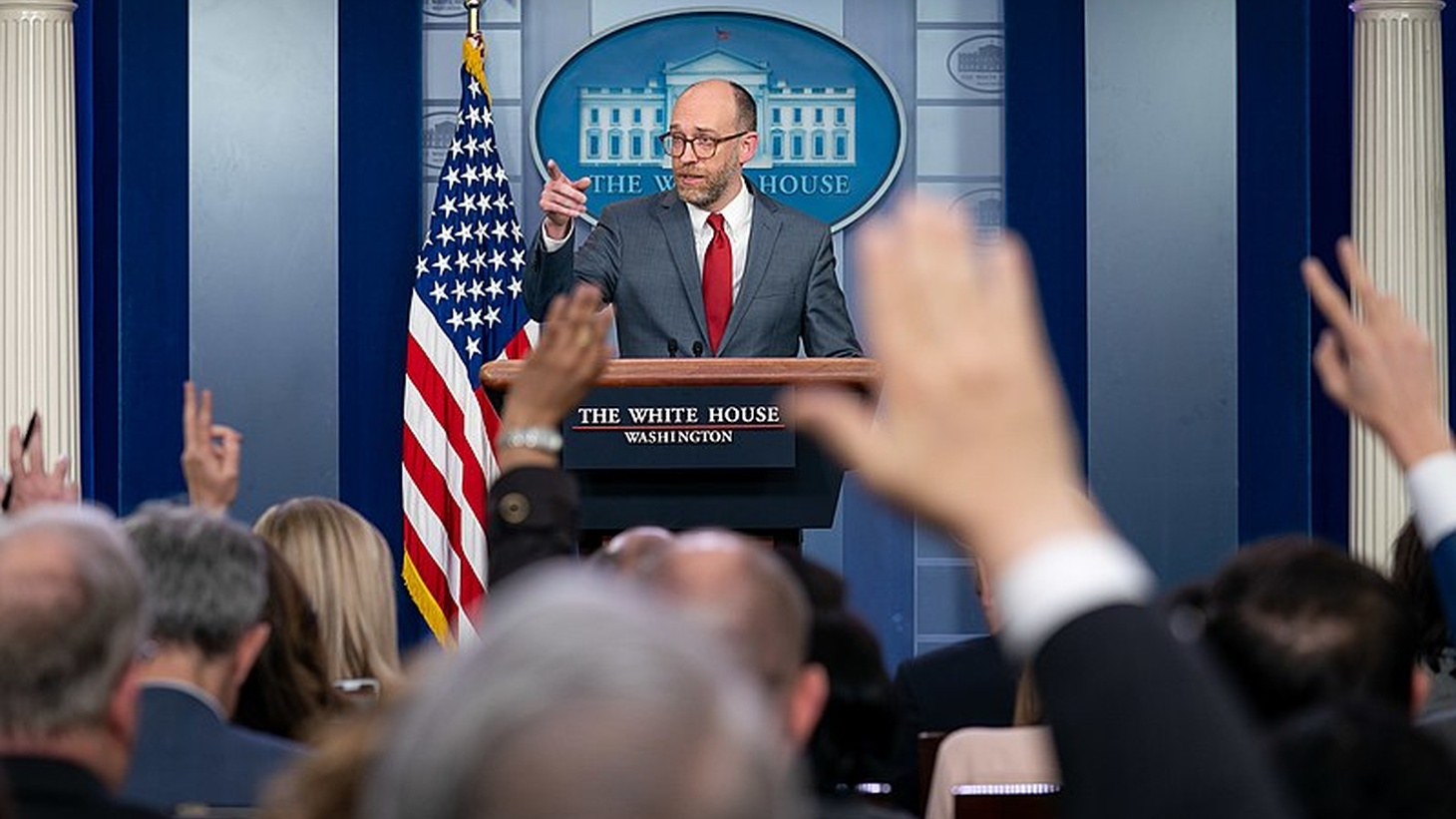 Reporters raise their hands to ask a question of Acting Director of the Office of Management and Budget Russell Vought during a press briefing Monday, March 11, 2019, in the James S. Brady Press Briefing Room of the White House.