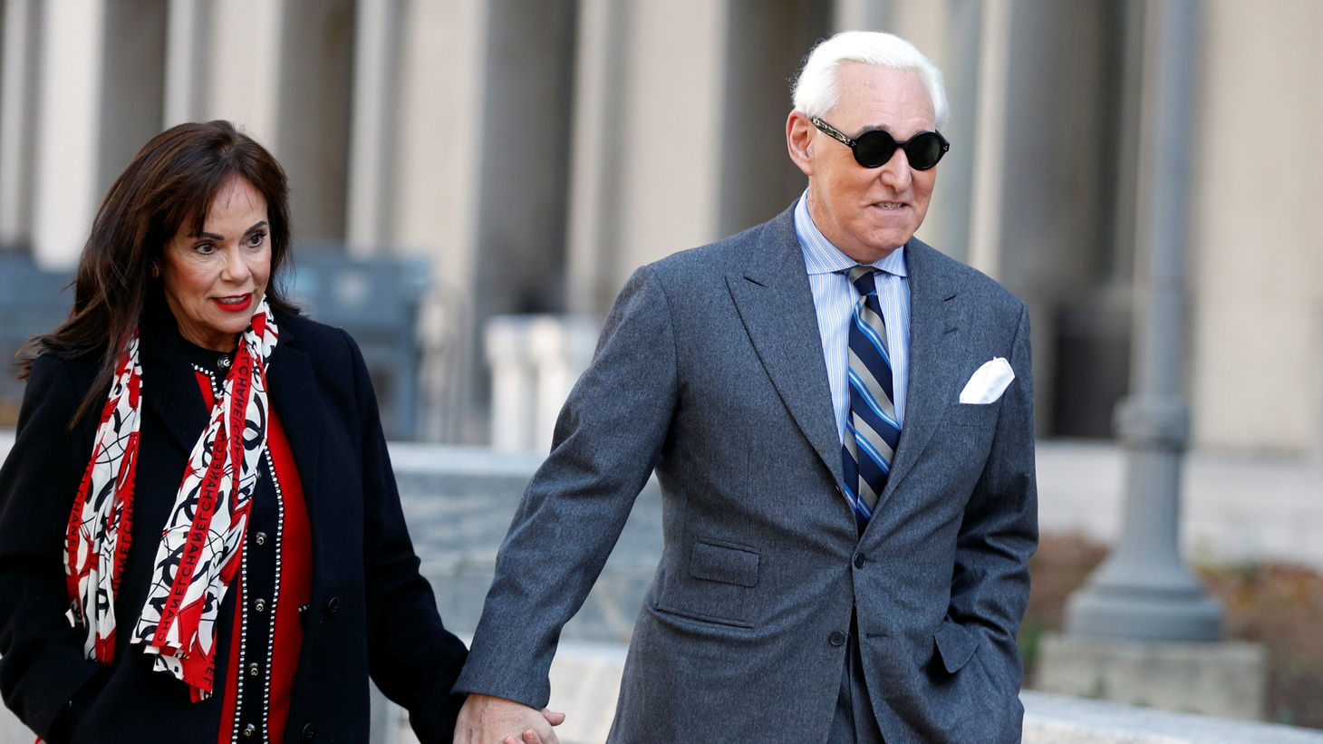 Roger Stone, former campaign adviser to U.S. President Donald Trump, arrives with his wife Nydia for the continuation of his criminal trial on charges of lying to Congress, obstructing justice and witness tampering at U.S. District Court in Washington, U.S., November 13, 2019.