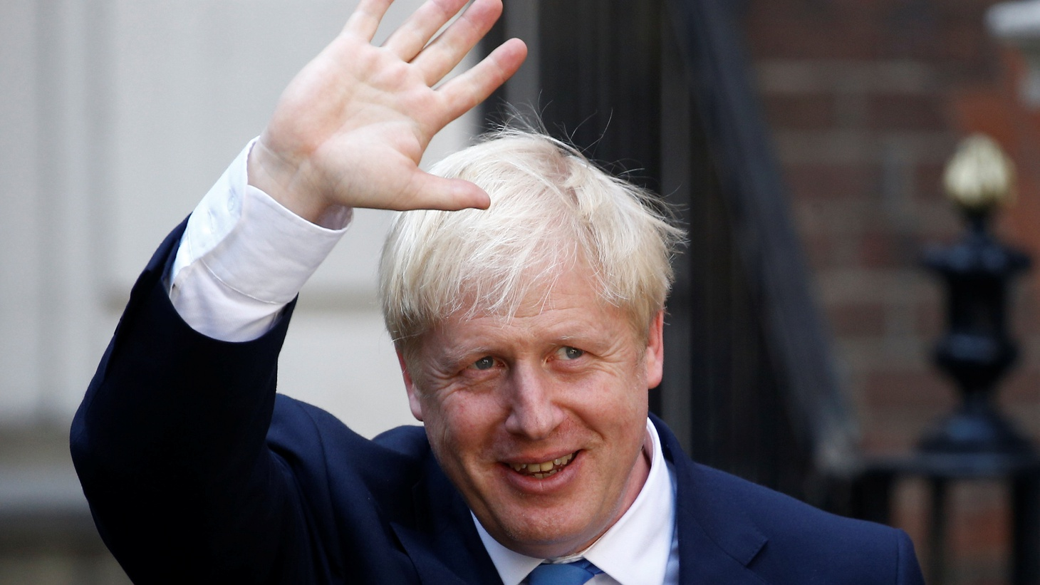 Boris Johnson, leader of the Britain's Conservative Party, leaves the party's headquarters in London.