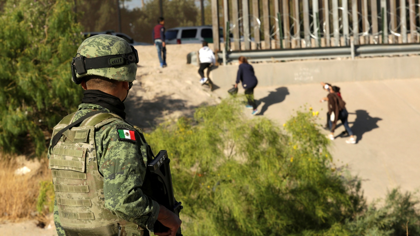 A member of the National Guard looks at migrants that crossed illegally into El Paso, Texas, U.S., from Ciudad Juarez, in Ciudad Juarez, Mexico June 19, 2019.
