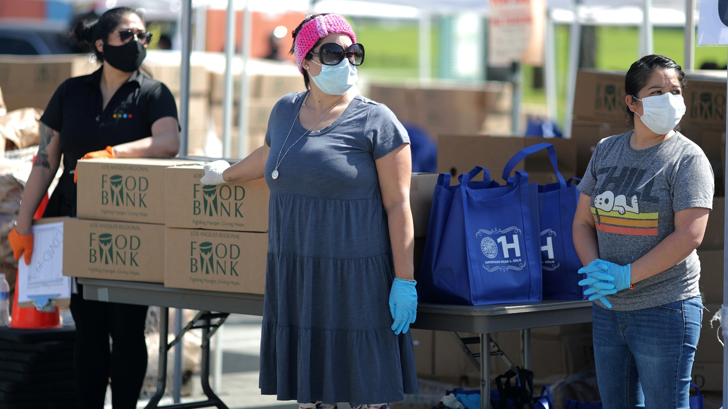 Volunteers at Los Angeles Food Bank hand out supplies at a drive-through food giveaway as the global outbreak of coronavirus disease (COVID-19) continues, in Los Angeles, California, U.S., April 21, 2020.