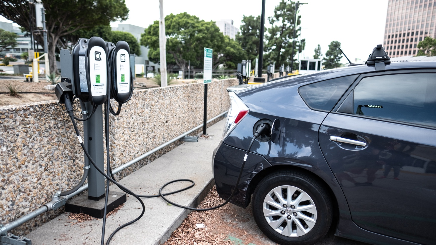 A Toyota Prius is plugged in at a public charging station in downtown Los Angeles. President Biden's new infrastructure plan includes money for building more electric vehicle charging stations.