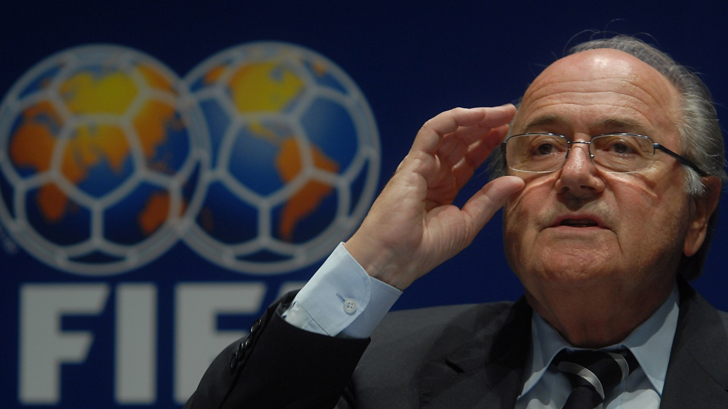 FIFA president Sepp Blatter is resigning amid a corruption scandal. After the TSA's failed security tests, its director steps down. Also, comedian Eddie Izzard discusses his latest show, Force Majeure.