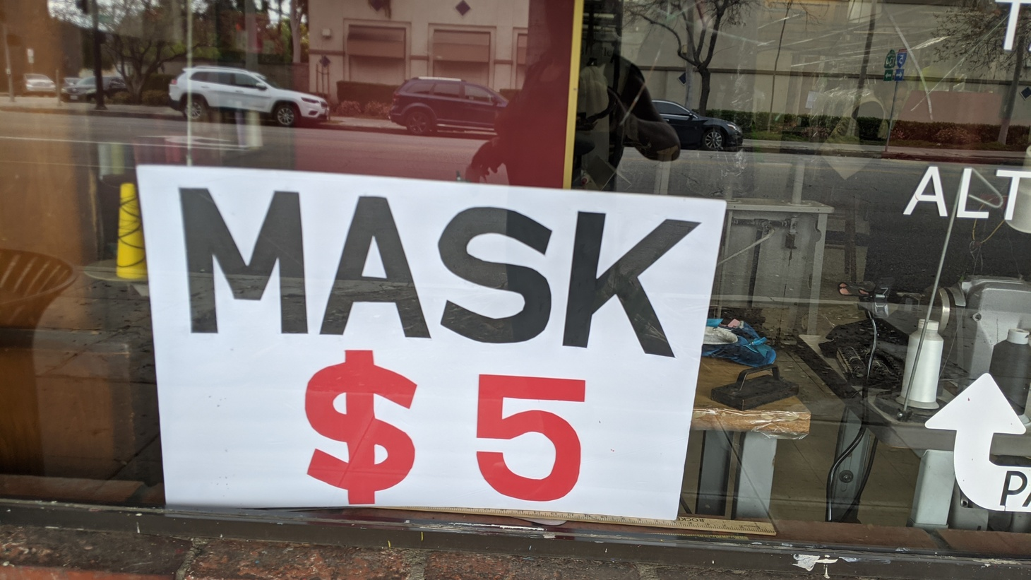 Californians must wear masks at essential businesses. This cleaners in Burbank, California is selling masks for $5 each.