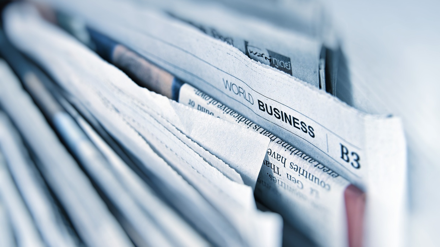 Newspapers and world business section.