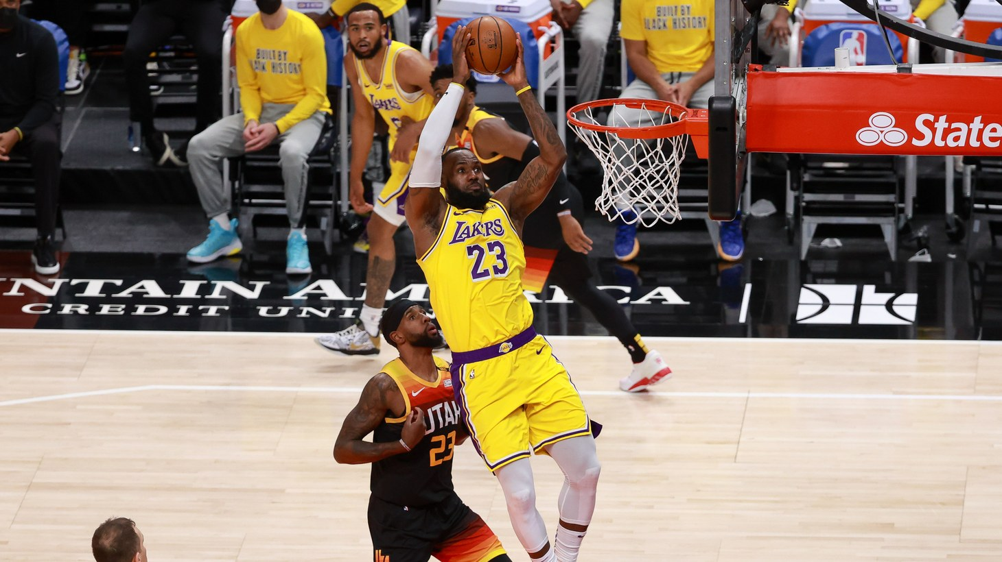 Los Angeles Lakers forward LeBron James (23) is fouled by Utah Jazz forward Royce O'Neale (23) while James tries to dunk the ball during the first quarter at Vivint Smart Home Arena, Feb 24, 2021; Salt Lake City, Utah, USA. A video of LeBron James recently sold for six figures.
