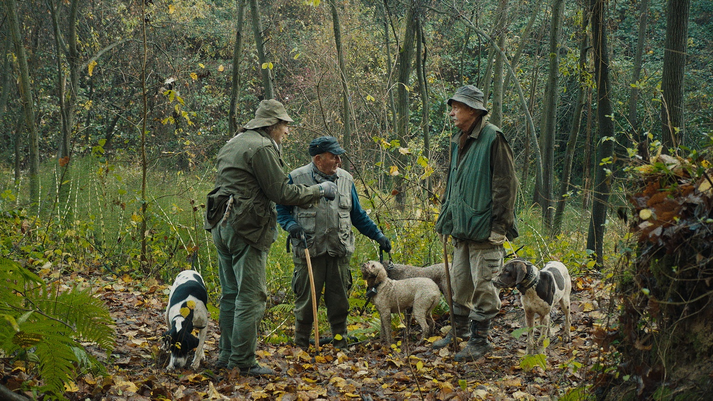 Sergio Cauda (left) with his dog Fiona and fellow truffle hunters.