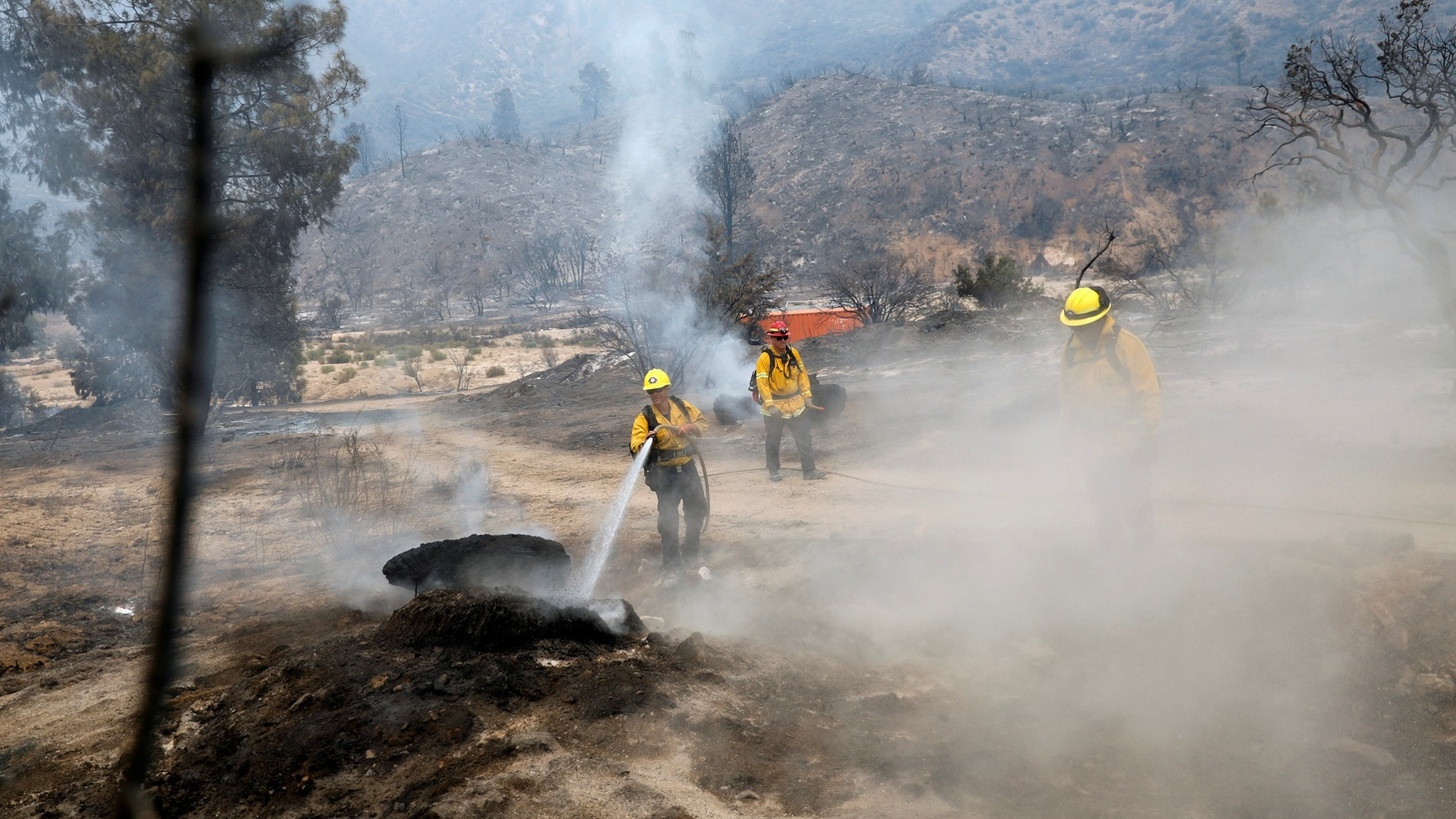 Firefighters extinguish hot spots as the fast-moving Lake Fire burns in a mountainous area of Angeles National Forest north of Los Angeles, California, U.S. August 13, 2020.
