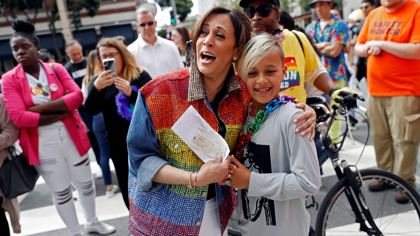 Democratic presidential candidate Kamala Harris reacts as Ryan Kyote donates to her campaign during the Pride Parade in San Francisco, California, U.S., June 30, 2019.