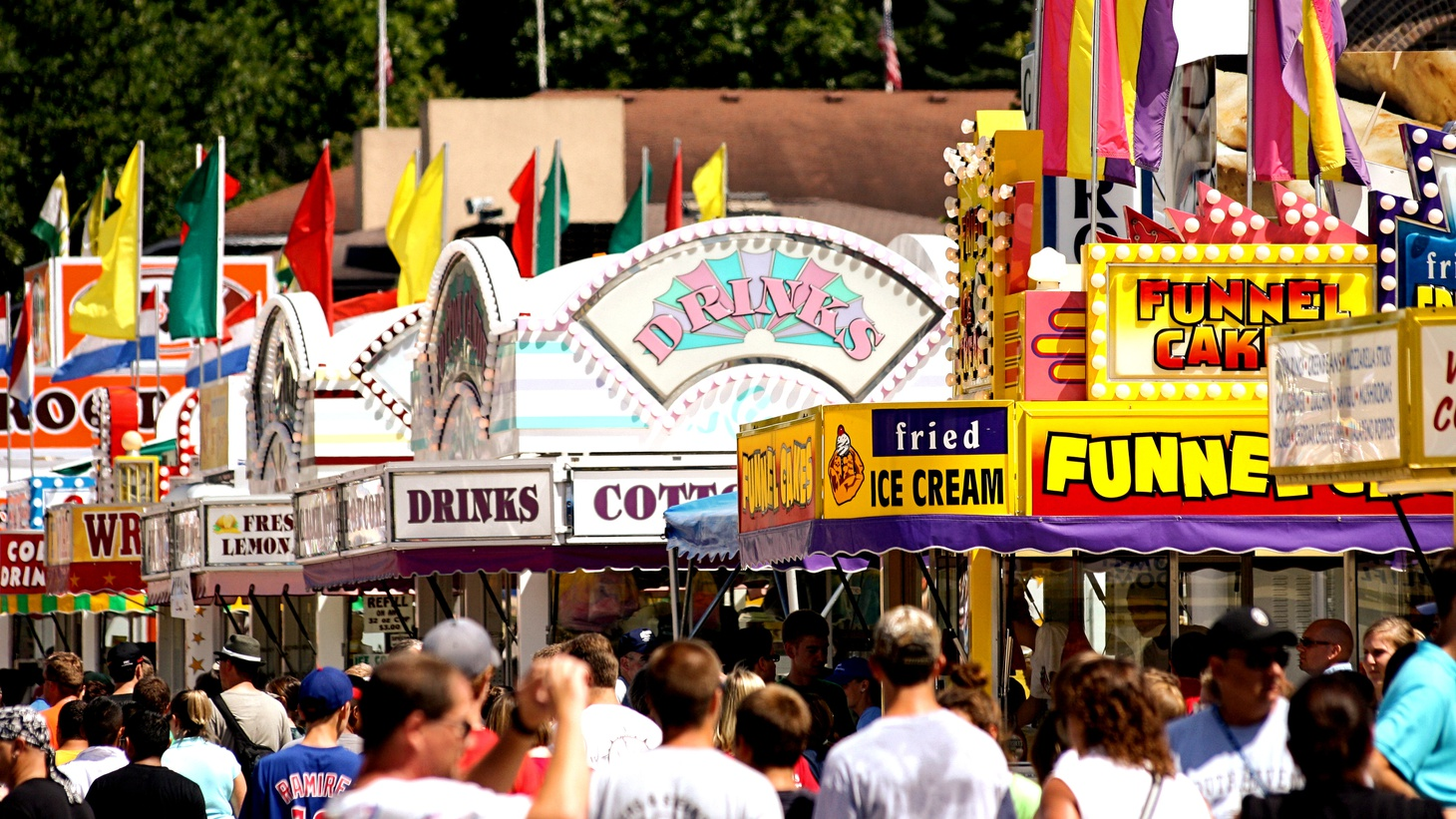 People scouting out their food choices at the Iowa State Fair.