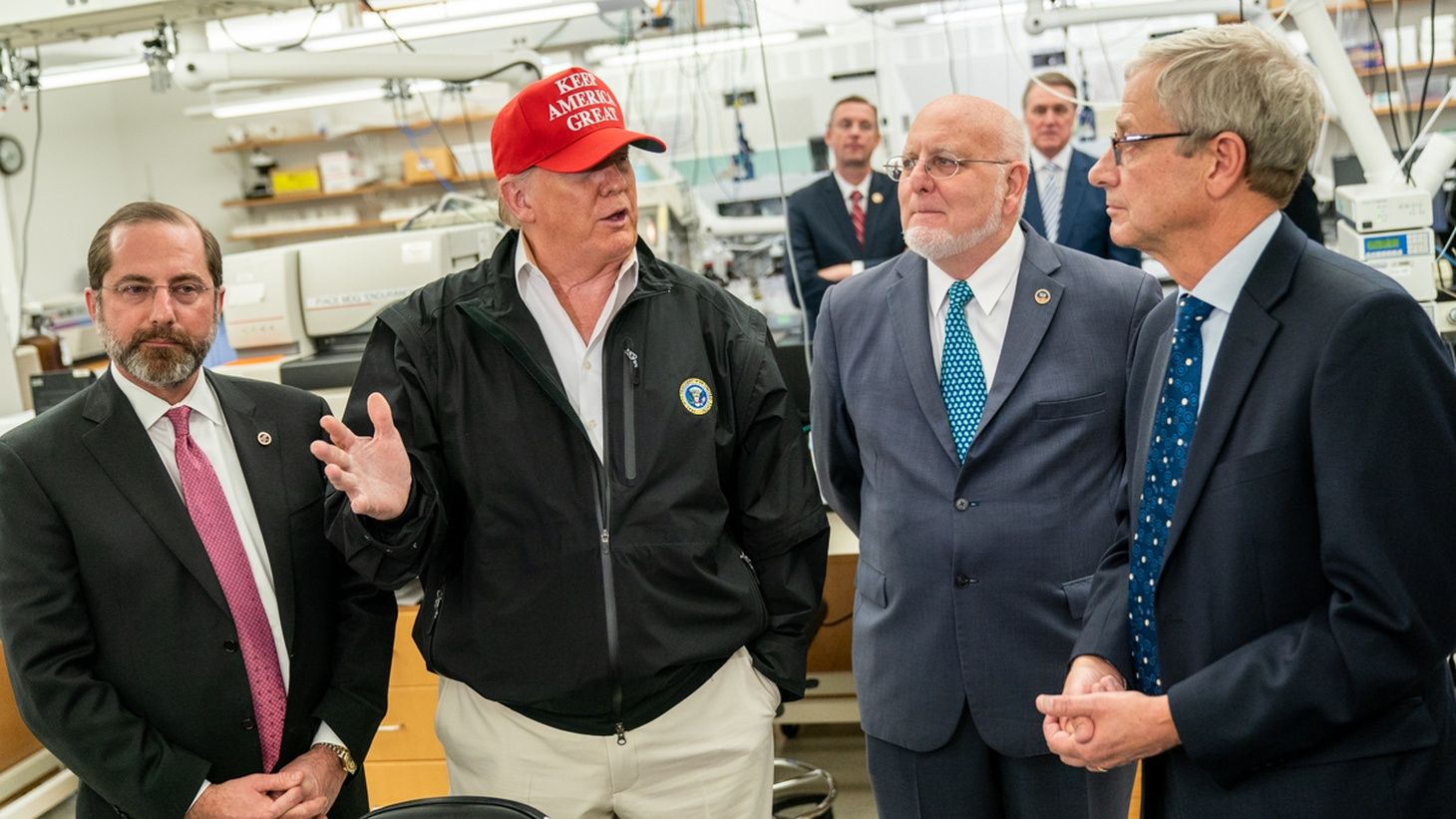President Donald J. Trump, joined by the Secretary of Health and Human Services Alex Azar (left), Dr. Robert R. Redfield, director of Centers for Disease Control and Prevention, and Dr. Stephan Monroe, associate director of the CDC (right), speaks with reporters during a visit to the CDC on March 6, 2020, in Atlanta.