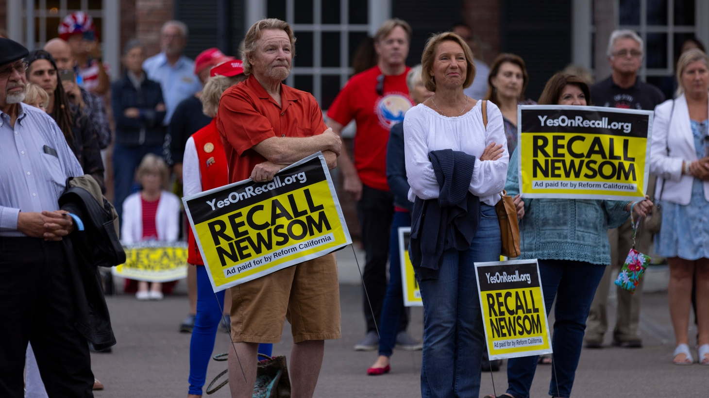 Supporters of the recall campaign of California Governor Gavin Newsom hold signs at a rally and information session in Carlsbad, California, U.S., June 30, 2021.