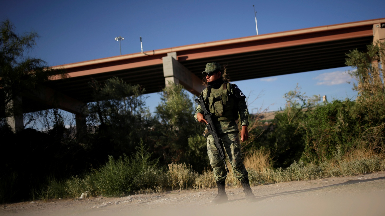 A National Guard soldier keeps watch at the border with El Paso, Texas, U.S., as seen from Ciudad Juarez, Mexico July 30, 2019.