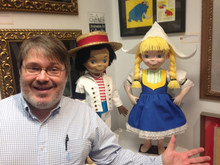 Eric J. Lawrence poses with children from It's a Small World