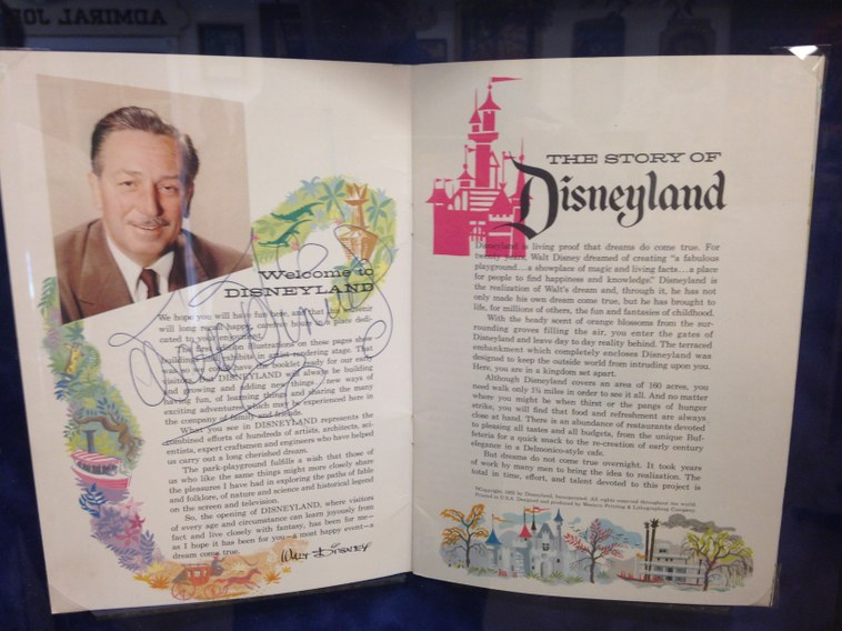An opening day program signed by Walt Disney is also for sale at the auction.