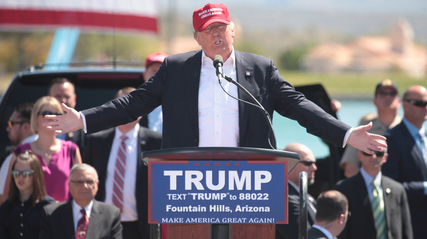 Donald Trump speaking with supporters at a campaign rally at Fountain Park in Fountain Hills, Arizona.