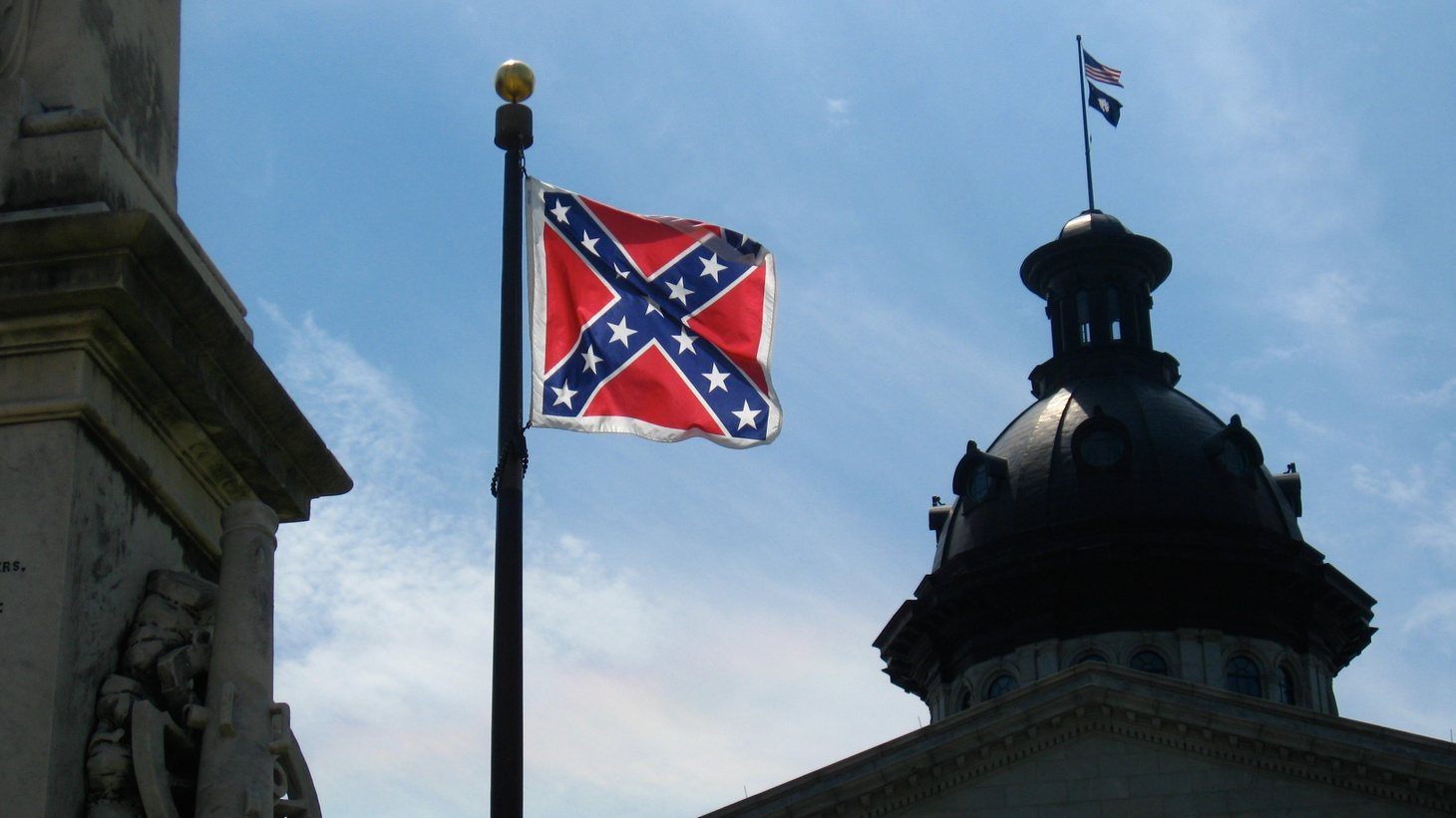 Why are politicians dodging questions about whether the confederate flag should be removed from the grounds of the South Carolina state capitol? Also, a look at the U.S. Supreme Court decisions handed down today, including one that overturns an L.A. law allowing the police to randomly search hotel and motel guest registries.