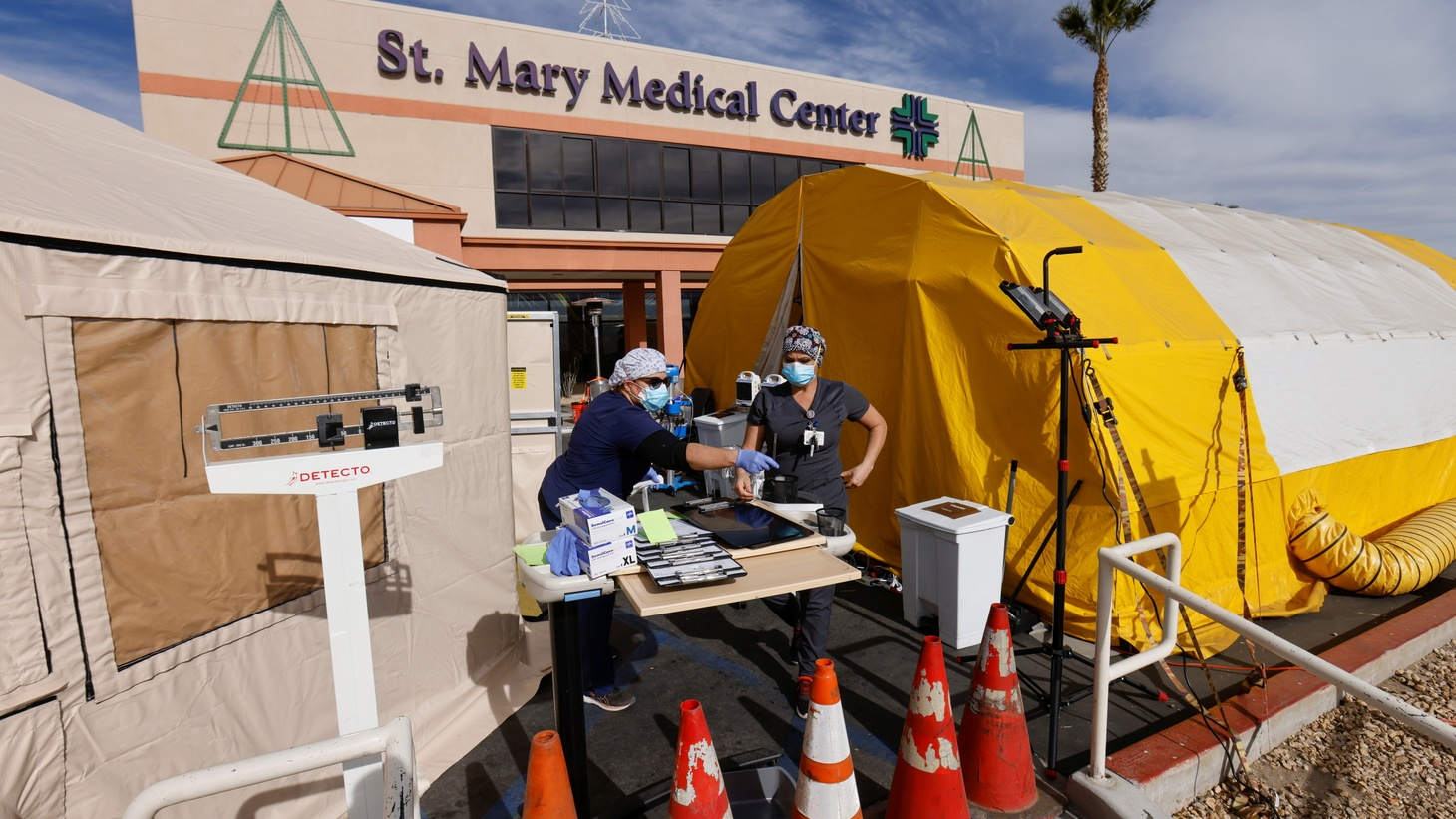 ER tech Brenda de la Cruz (R) and registered nurse Janet Hays work outside St. Mary Medical Center in the triage tents during the outbreak of COVID-19 in Apple Valley, California, U.S., December 8, 2020.