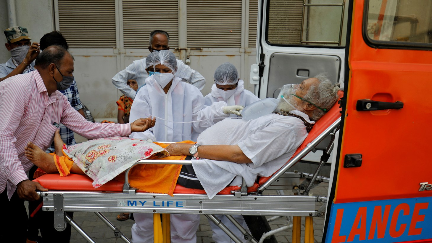 A patient wearing an oxygen mask is wheeled inside a COVID-19 hospital for treatment, amidst the spread of the coronavirus disease (COVID-19) in Ahmedabad, India, April 26, 2021.