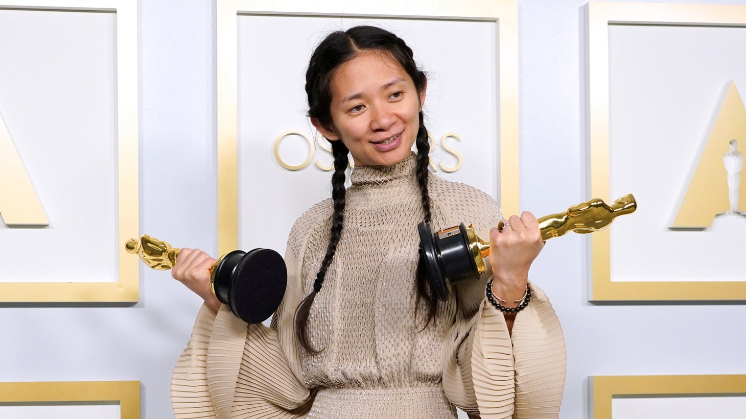 """Director/producer Chloé Zhao, winner of Best Picture for """"Nomadland,"""" poses in the press room at the Oscars, in Los Angeles, California, U.S., April 25, 2021."""
