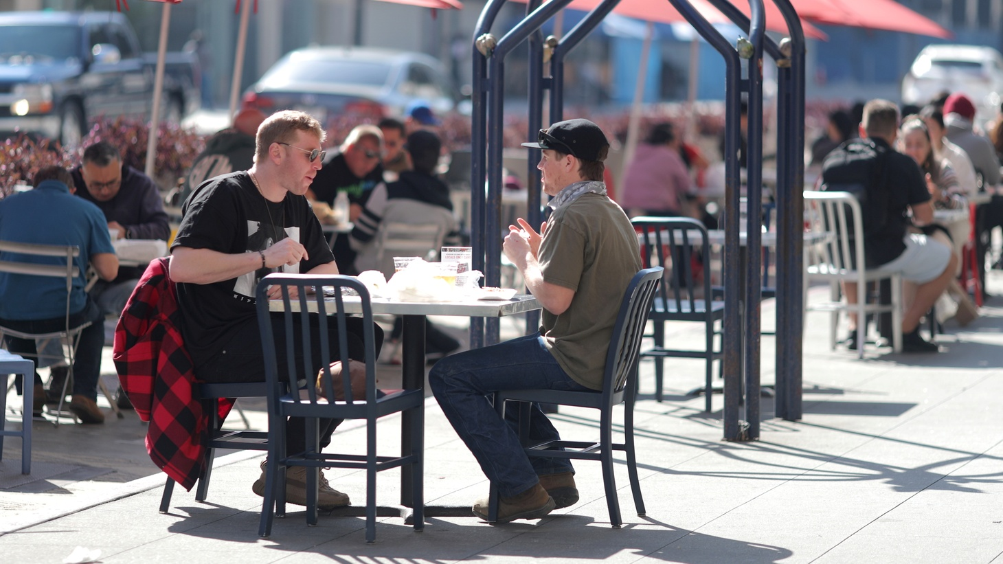 People eat at outdoor dining tables at Grand Central Market, as the coronavirus disease (COVID-19) outbreak continues, in Los Angeles, California, U.S., February 3, 2021.