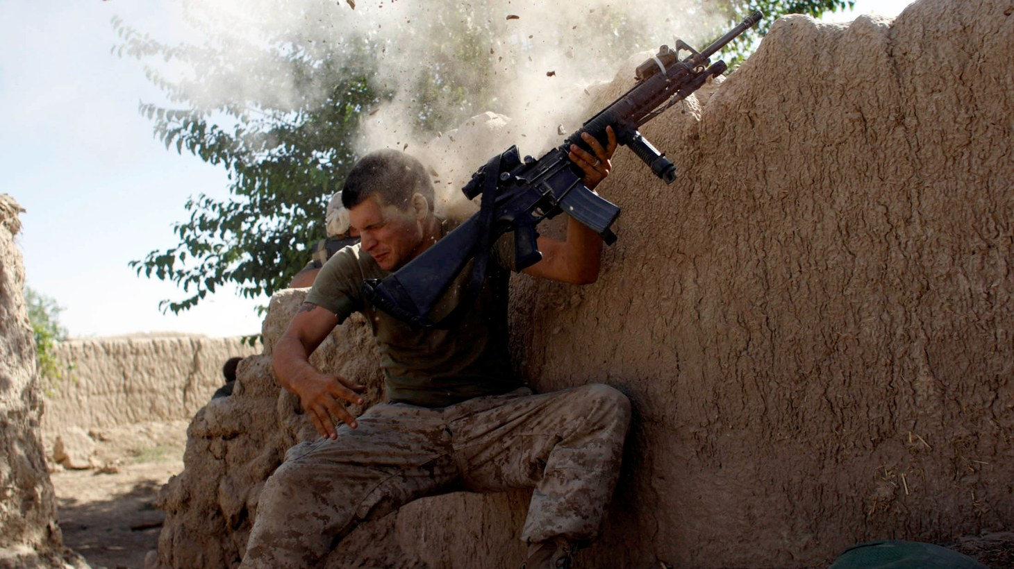 Sgt. William Olas Bee, a U.S. Marine from the 24th Marine Expeditionary Unit, has a close call after Taliban fighters opened fire near Garmser in Helmand Province of Afghanistan May 18, 2008.
