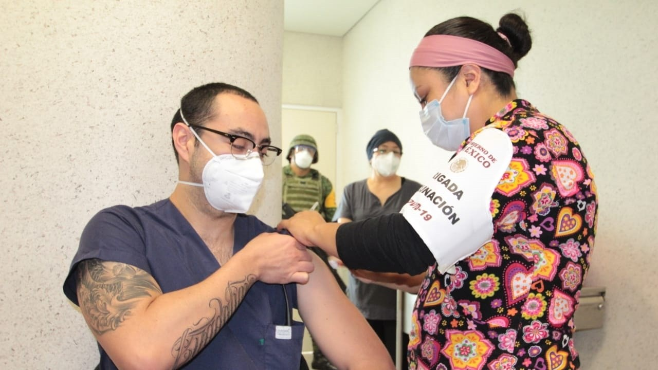 In Mexico City, Mexico, health professionals participate in a vaccination session against the coronavirus on January 16, 2021. The president, Andrés Manuel López Obrador, reported that by January 14, 329,983 people have been vaccinated against COVID-19 to health personnel working on the front lines against the virus.