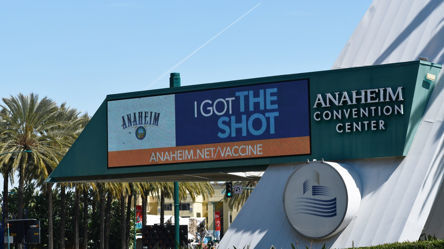 """The Anaheim Convention Center serves as a mass coronavirus vaccination site in Orange County, California. The marquee says """"I got the shot."""" March 19, 2021."""
