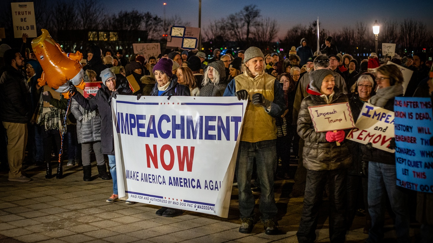 Hundreds of people gather in front of the Iowa State Capitol in Des Moines calling for the impeachment of Donald Trump.
