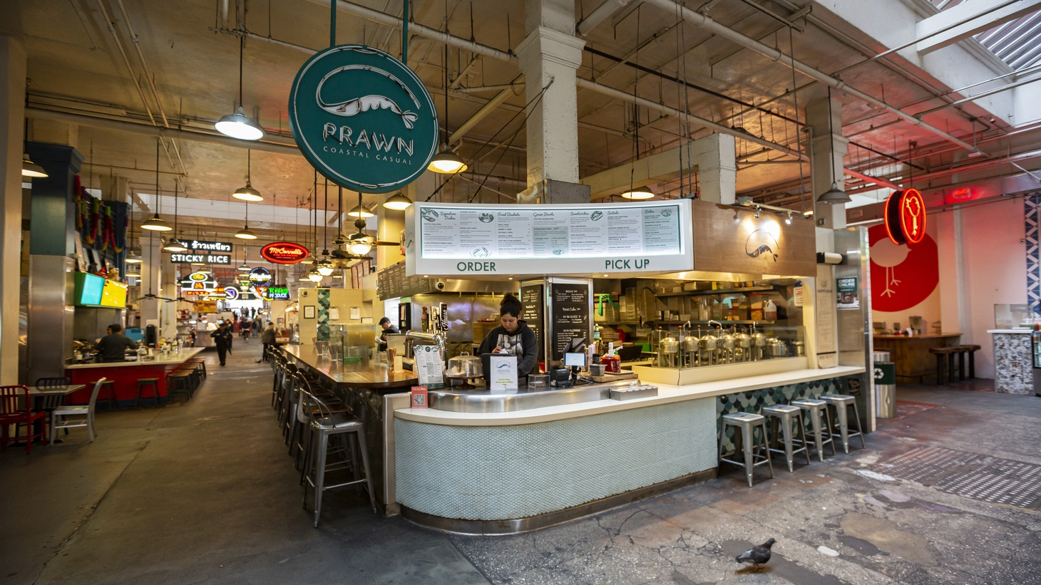 Empty seats at Prawn, a seafood restaurant inside LA's Grand Central Market.