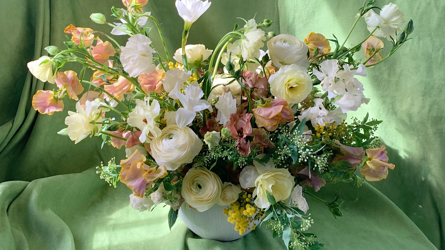Sending and receiving flowers has been one way of staying connected to other people and nature while being sheltered at home. Here's one artful arrangement of spring flowers by Whit Hazen.