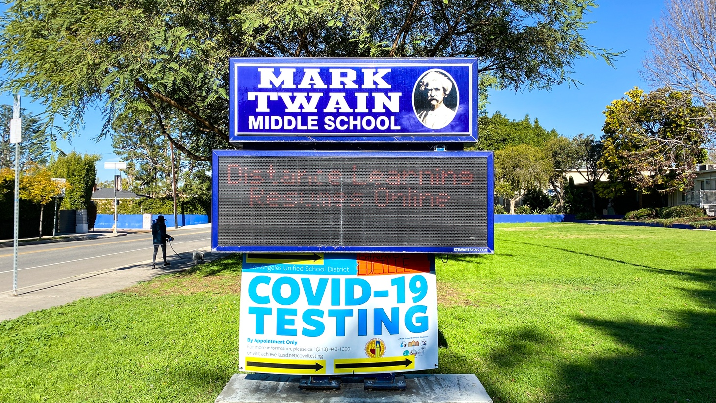 The sign outside Mark Twain Middle School in Mar Vista, Los Angeles points to online resources for distance learning, February 2, 2021.