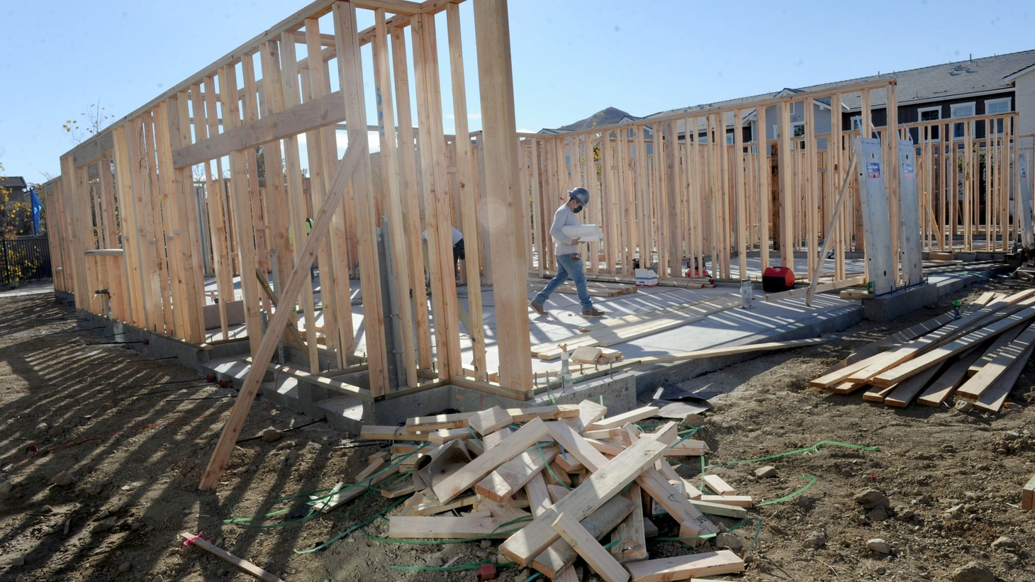 Construction workers frame one of the last units of condos at the Westerly townhomes in Simi Valley on Wednesday, Dec. 2, 2020. The development has seen an uptick in sales during the COVID-19 pandemic.