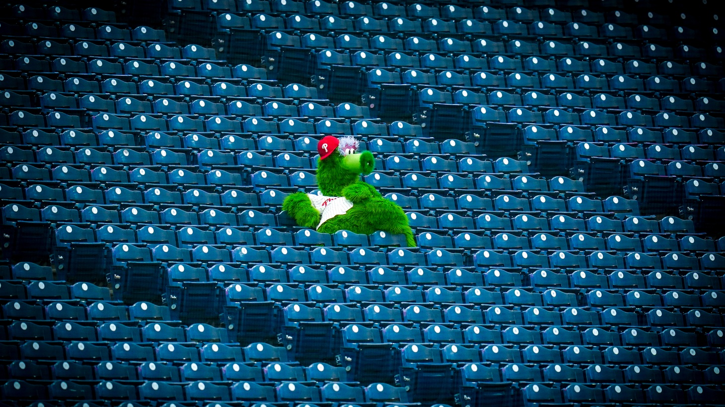 The Phillie Phanatic sits in an empty stadium as fans are watching games from home during the coronavirus pandemic.