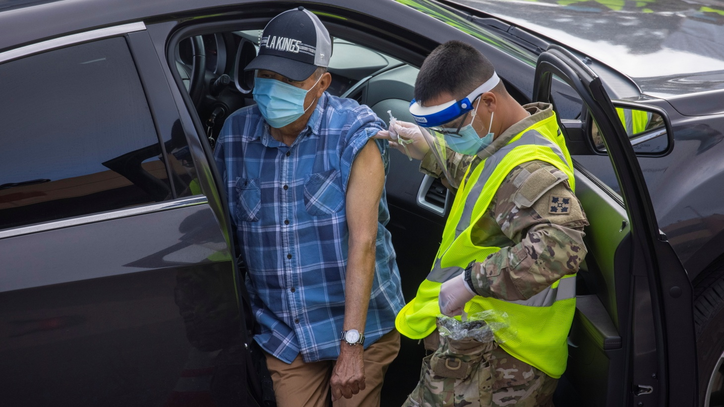 A person is vaccinated by the U.S. military at the opening of the country's first federal and state operated community vaccination site during the outbreak of the coronavirus disease (COVID-19) in Los Angeles, California, U.S., February 16, 2021.