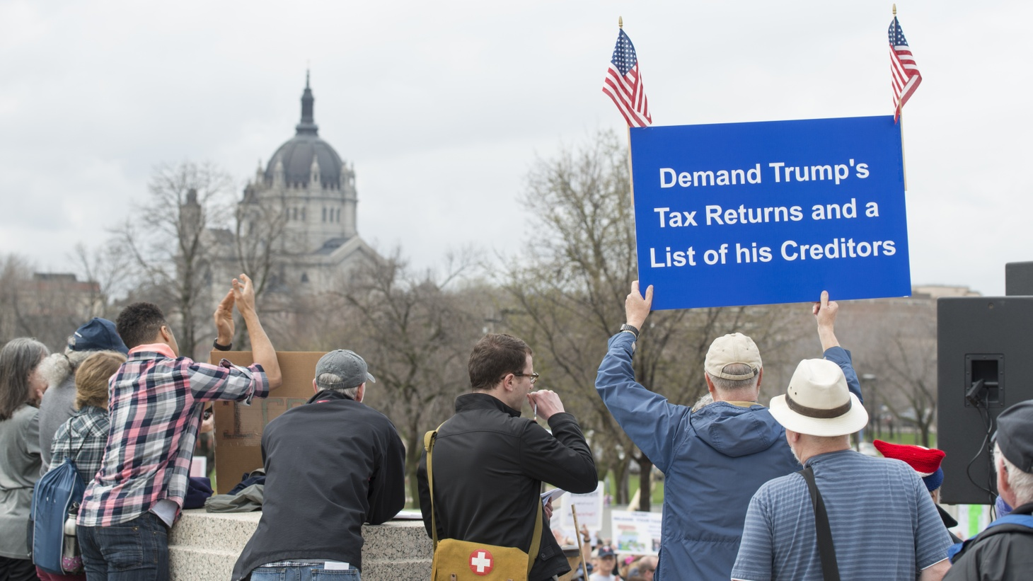 People at the Minnesota capitol grounds called on Donald Trump to release his tax returns, divest his holdings, and disclose his conflicts of interest, April 15, 2017. On February 22, 2021, the Supreme Court rejected bids from Trump to keep his tax returns secret.