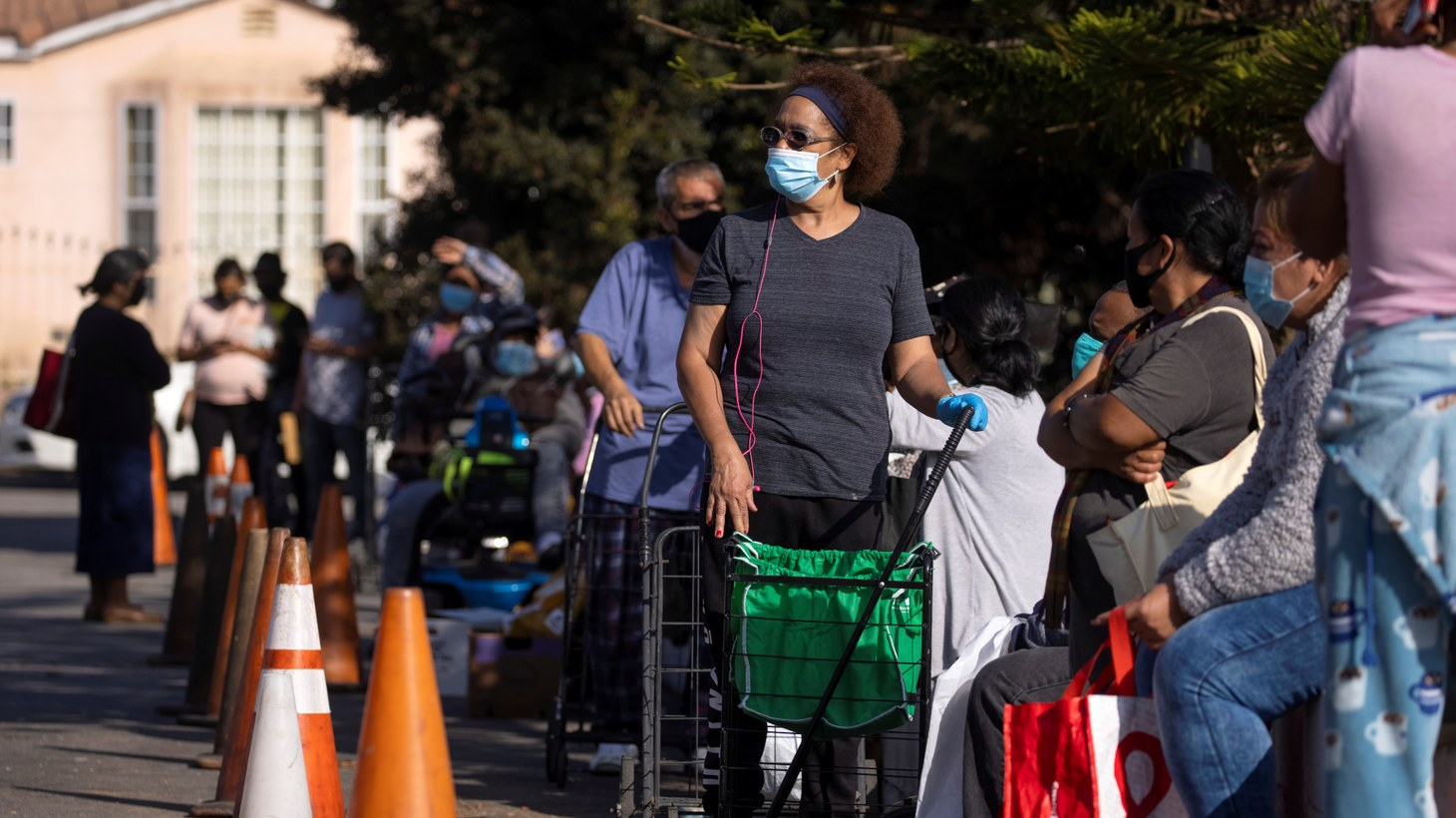 People wait in line as the Los Angeles Regional Food Bank distributes food outside a church during the outbreak of the coronavirus disease (COVID-19) in Los Angeles, California, U.S., November 19, 2020.