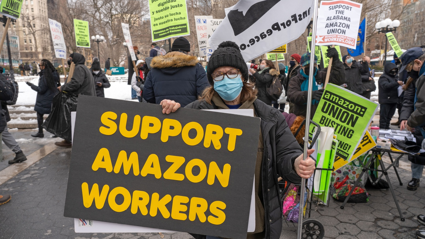 Protestors in New York City hold signs and march on a picket line across from Amazon's Whole Foods Market — in solidarity with the Amazon workers in Bessemer, Alabama who were trying to unionize, February 20, 2021.
