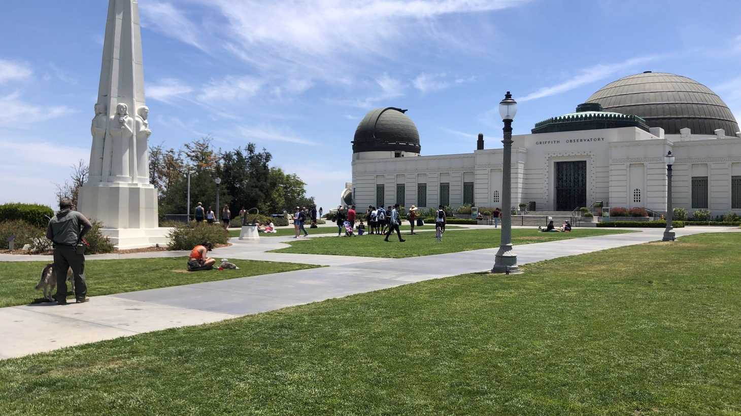 LA residents relax on the lawn outside the Griffith Observatory, which has been closed for more than a year because of the pandemic. June 5, 2021.