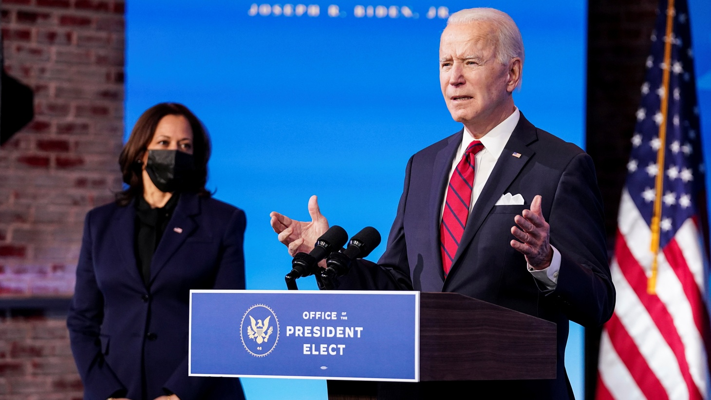 U.S. President-elect Joe Biden speaks about his plan to administer coronavirus disease (COVID-19) vaccines to the U.S. population as Vice President-elect Kamala Harris listens during a news conference at Biden's transition headquarters in Wilmington, Delaware, U.S., January 15, 2021.