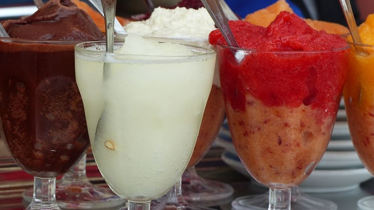 A granita is made up of sweetened fruit juice or pureed fruit that is frozen and raked/massaged to a texture that's crystalline instead of smooth. A granita is not a sorbet.