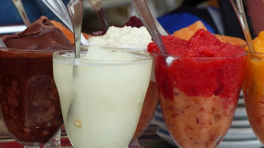 A granita is made up of sweetened fruit juice or pureed fruit that is frozen and raked/massaged to a texture that's crystalline.