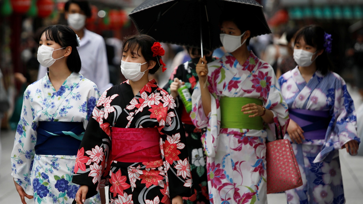 Women wear protective face masks as they walk along Nakamise Street at Asakusa district amid the coronavirus disease (COVID-19) outbreak in Tokyo, Japan, July 22, 2020.