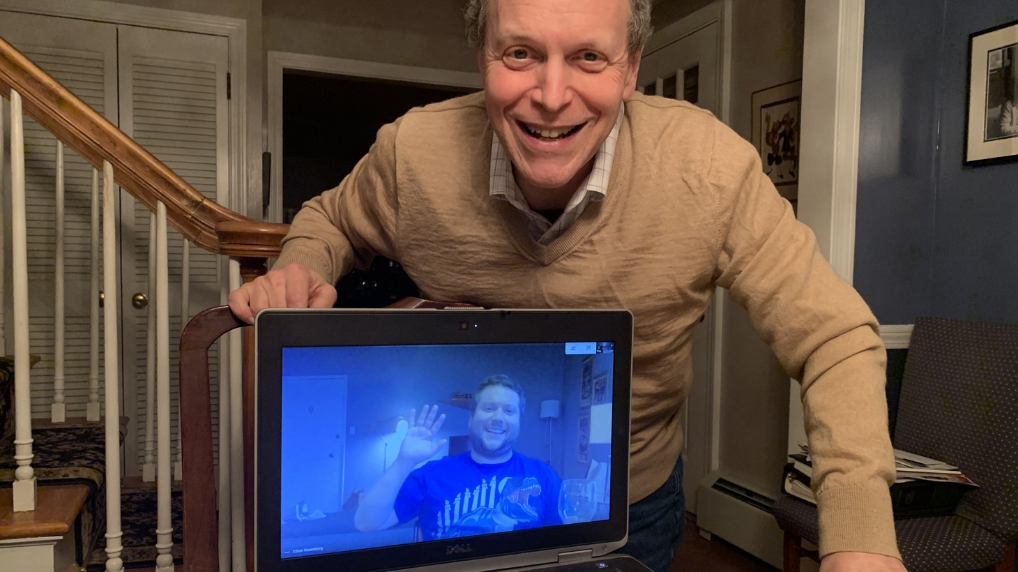 Alan Rosenberg and his son Ethan use web cameras to connect for their Passover Seder. April 9, 2020.