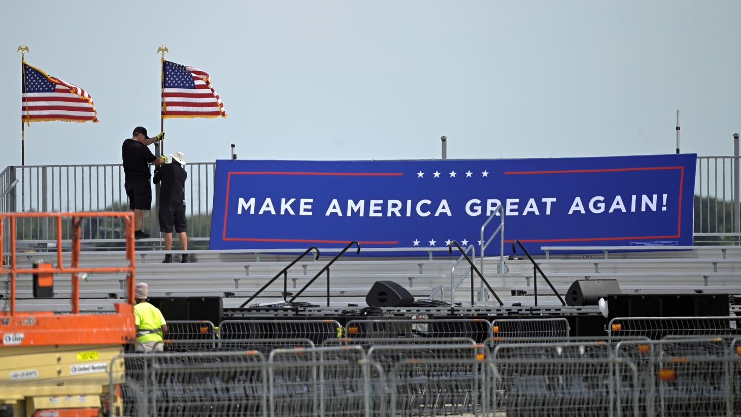 Donald Trump's campaign rally was scheduled for today at the Orlando Sanford International Airport in Sanford, Florida. But following Trump's announcement that he tested positive for COVID-19, workers are pulling down a sign at the rally location. October 2, 2020.