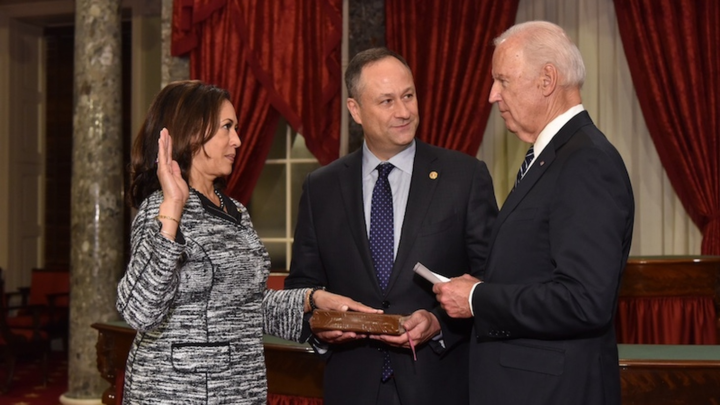 January 3, 2017: Kamala Harris takes the oath of office as United States Senator with Vice President Joe Biden (right) and Douglas Emhoff (center).
